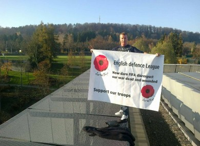 One member of the EDL on the FIFA building earlier today.