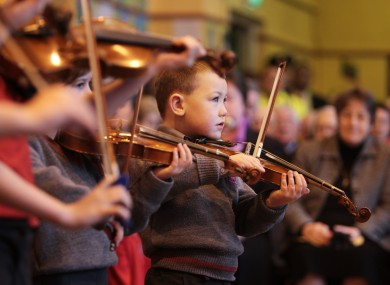 Children at St Agnes' Primary School perform for President Michael D Higgins today
