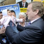 Emma Brady, age 8 months, is immortalised in another Enda Kenny GE11 walkabout. Pic: Sasko Lazarov/Photocall Ireland