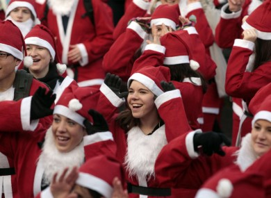 People dressed as Father Christmas take part in the Great Edinburgh Santa Run earlier today