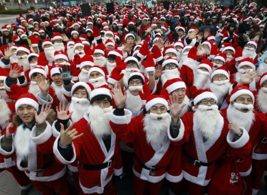 But which is the real Santa? 1,000 volunteers donned costumes to deliver gifts to the poor in South Korea