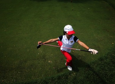 Ada Li, 11, stretching before her round of golf.
