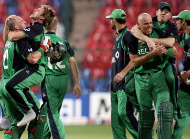 Ireland's cricketers celebrate their historic scalp against England at the Cricket World Cup.