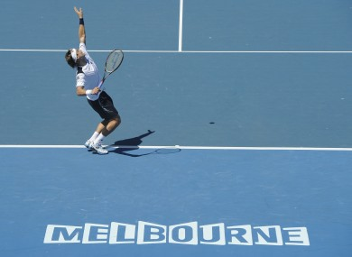David Ferrer of Spain serves to Rui Machado of Portugal during their first round match at the Australian Open.