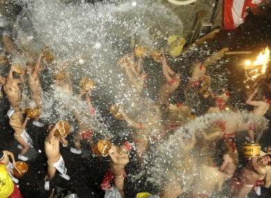 Men take part in the traditional 'splashing festival' in Naganoharamachi, Japan