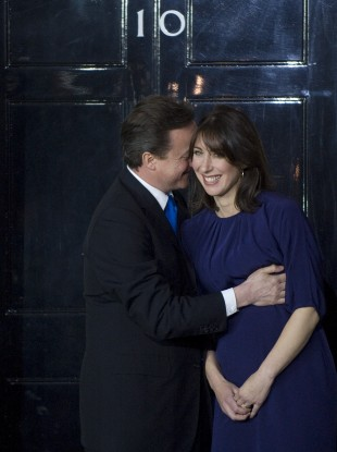 Cameron and his wife enter Downing Street on the night he formed a coalition government in May 2010.