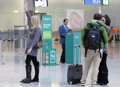 Bernadette Kelly from Foxrock wave goodbye as her daughter Anne and her three grandchildren disappear through security today at Dublin Airport.