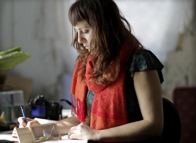 Amber Hansen works in her studio in Lawrence, Kansas