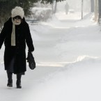 An elderly woman walks on snow covered sidewalk on a cold winter day in Sofia, Bulgaria today. (AP Photo/Valentina Petrova/PA Images)