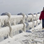 A child walks along a sea wall covered in ice on the frozen shores of the Black Sea in Constanta, Romania today. (AP Photo/Vadim Ghirda/PA Images)