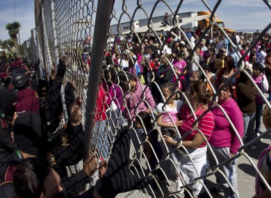Police hold back the relatives of inmates outside the Apodaca correctional state facility as they try to get past the gates in Apodaca on the outskirts of Monterrey, Mexico.