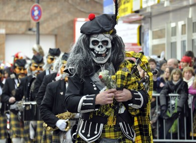 An eerie piper participating in a carnival parade in Cologne, Germany today.