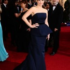 Tina Fey in custom Carolina Herrera which also featured a peplum detail. The fashion house said it wanted to design for one actress only for the biggest night of the year - and Fey won out. Again, this one is dark navy and not black as it appears.