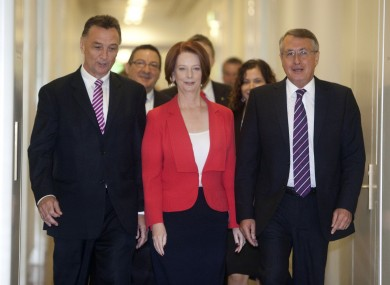 Australian Prime Minister Julia Gillard, centre, accompanied by supporters Craig Emerson (L) and Wayne Swan leave a caucus meeting after she won the vote for party leadership at Parliament House in Canberra.