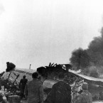 The wreckage burns after its crash while attempting to take off.