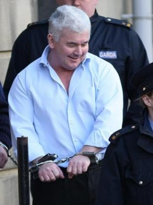 File photo from February 2008 of John Gilligan leaving the Four Courts in Dublin.