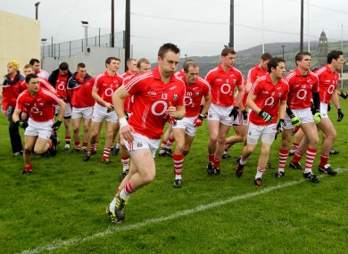 Paul Kerrigan (front) breaks from his Cork team-mates as they come out for the McGrath Cup final.
