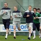 John O'Shea and Damien Duff lead the warm-up.<span class=