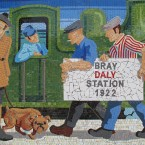 Newly refurbished mosaic at Bray Dart station shows uniformed 'Black andTan' figure with dog with Union Jack collar. (Via mural-to-mosaic.blogspot.com)
