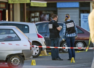 Investigators on the scene of the shootings in Montauban.