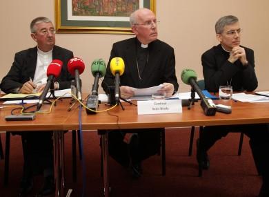 Archbishop of Dublin Diarmuid Martin, Cardinal Sean Brady and papal nuncio to Ireland Archbishop Charles Brown during a press conference in Maynooth this morning.