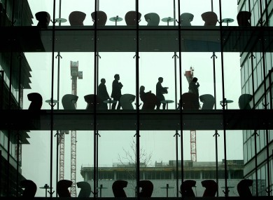 Financial services workers at the IFSC: the financial services sector is likely to create 10,000 jobs in the next three years, according to a new survey of foreign investors.