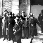 Collins (marked with an 'X' in this PA Archive image), head of the provisional Government, leaving Dublin Castle with Kevin O'Higgins and WT Cosgrave after the British surrender ceremony in January 1922.
