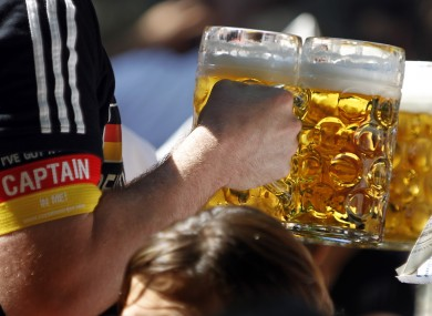 A German supporter carries beer glasses at the last World Cup in South Africa.