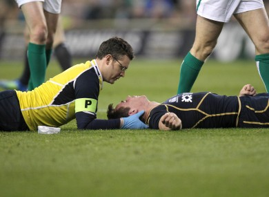 Jones is carefully treated by Scottish team doctors during a lengthy delay in the second half of yesterday's Six Nations match.