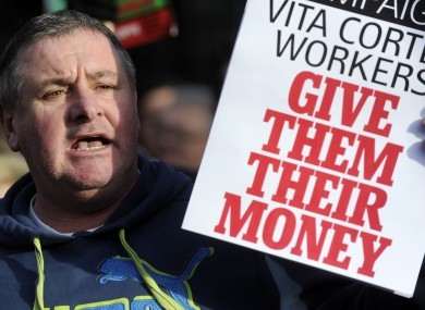 Pat Gorman from Cork shows his support for Vita Cortex workers at a public rally outside Leinster House in Dublin in January.