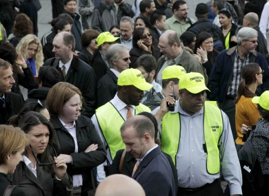 Members of the evacuation team stand among other office workers after 2 World Financial Center was briefly evacuated in New York.