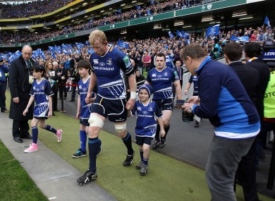 Leo Cullen leads out the Leinster mascots at the Aviva Stadium