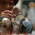 Marija Jozanov paints incredibly Orthodox icons on ostrich eggs, as she decorates them for Easter in Novi Sad, 80 km north of Belgrade. Orthodox Serbs celebrate Easter according to Julian calendar. (AP Photo/Srdjan Ilic)