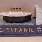A coin placed on the Titanic mechanical bank 'sinks' into the bank after the ship crashes into the iceberg. Available for $37.99 from chandelierforum.com.