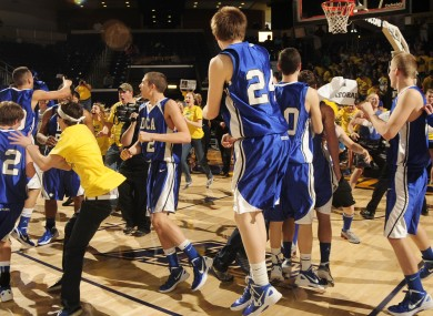 Tennessee high school players celebrate after a win in March.
