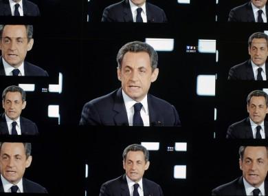 Sarkozy on TV screens during a debate with Hollande