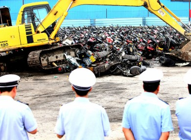 More than 4,000 confiscated illegal motorbikes are destroyed by diggers in the city of Foshan, Guangdong, China.