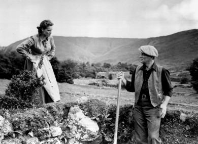 Maureen O'Hara and John Wayne converse in a scene from The Quiet Man.