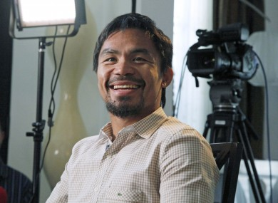 Manny Pacquiao, world champion boxer and Filipino congressman, smiles during a break while speaking about his views on same-sex marriage yesterday.