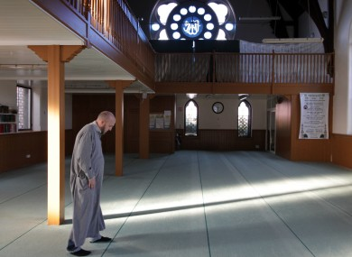 A man prepares to pray in the Dublin Mosque on South Circular Road