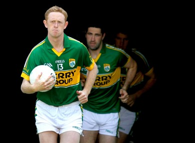 Colm Cooper leads out his side.