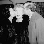 Hollywood's Marilyn Monroe gets farewell kisses on both cheeks from actor Sir Laurence Olivier and his actress wife Vivien Leigh at London airport. Miss Monroe was about to board a Pan American liner with her husband, American playwright Arthur Miller, to fly back to the United States after making her first British film 'The Sleeping Prince' with Sir Laurence at Pinewood Studios. (AP Photo)