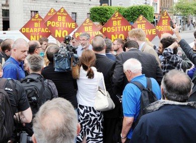 Scrum: Gerry Adams and other Sinn Féin party members speak to the media on O'Connell Street in Dublin this evening.