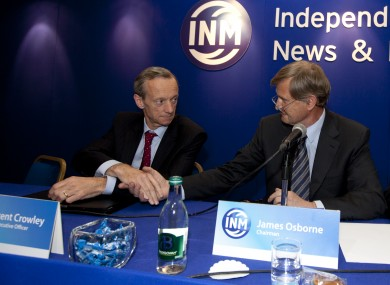 Outgoing Chairman James Osborne (R) shakes hands with CEO Vincent Crowley at the Independent News & Media AGM in Citywest, Dublin today