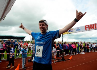 Alan Corcoran completing his 35-marathon run.