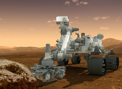 Artist's depiction of the Curiosity rover at work on Mars.