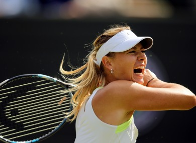 Russia's Maria Sharapova in action against Chinese Taipei's Su-Wei Hsieh