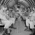 American paratroopers sit in a military plane as they soar over the English Channel en route to Normandy for the invasion on 6, June 1944. (AP Photo)