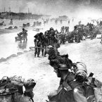 Wounded British troops from the South Lancashire and Middlesex regiments are helped ashore at Sword Beach during the D-Day invasion. (AP Photo)