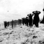 German prisoners of war are led away by Allied forces from Utah Beach on 6 June, 1944. (AP Photo)